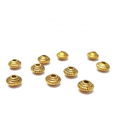 Perles metal toupie 5 x 3 mm doré